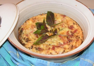 ...simple zucchini and bacon fritatta, topped of with a garnish of freshly picked opal basil