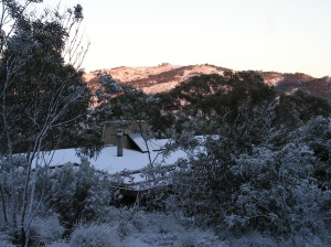Morning light tinges the snow on the Hill across the Valley a soft, rosy pink